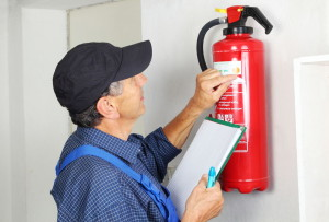 32308921 - a professional checking afire extinguisher